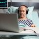 Senior sick man in hospital bed breathing through oxygen mask - PhotoDune Item for Sale