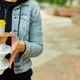 Woman walking in the park, holding a take away food and coffee - PhotoDune Item for Sale