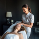 Young sexy woman in spa gets a facial massage - PhotoDune Item for Sale