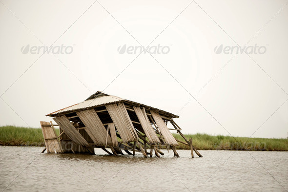 Collapsed stilt house - Stock Photo - Images
