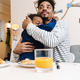 African american father and son hugging while having breakfast - PhotoDune Item for Sale