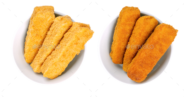 Vegan fishless fingers, pre-fried and deep-fried, in white bowls - Stock Photo - Images