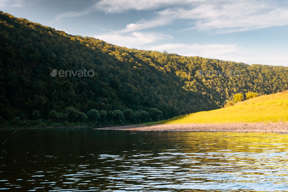Summer river and lush autumn forest at sunrise time - Stock Photo - Images