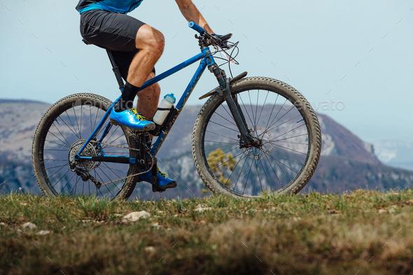 closeup man on mountain bike riding trail - Stock Photo - Images