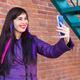 Pretty girl with long coloured hair takes a selfie on the rooftop - PhotoDune Item for Sale