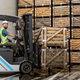 Employee on electric forklift carry container with ripe apples at storage - PhotoDune Item for Sale