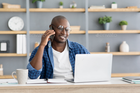 Mobile business communication and entrepreneurship concept. Happy african american businessman - Stock Photo - Images