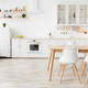Minimalist kitchen design in scandinavian style. Dining table with tulips and furniture with - PhotoDune Item for Sale