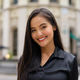 Portrait of beautiful Asian businesswoman outdoors in city street smiling while looking confident - PhotoDune Item for Sale