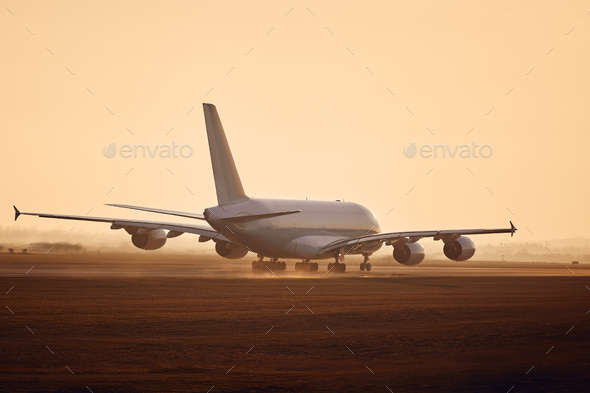 Airplane taking off from airport runway - Stock Photo - Images
