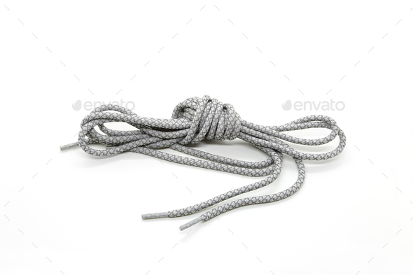 New shoelaces tied in a knot isolated on white background - Stock Photo - Images