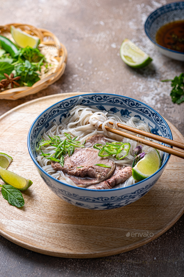 Rice noodles soup with beef and herbs, vietnamese cuisine - Stock Photo - Images