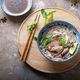 Top view of pho bo vietnamese rice noodle soup with herbs and sauce - PhotoDune Item for Sale