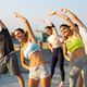 Group of happy friends working out together outdoors. Fitness, training, sport and people concept - PhotoDune Item for Sale