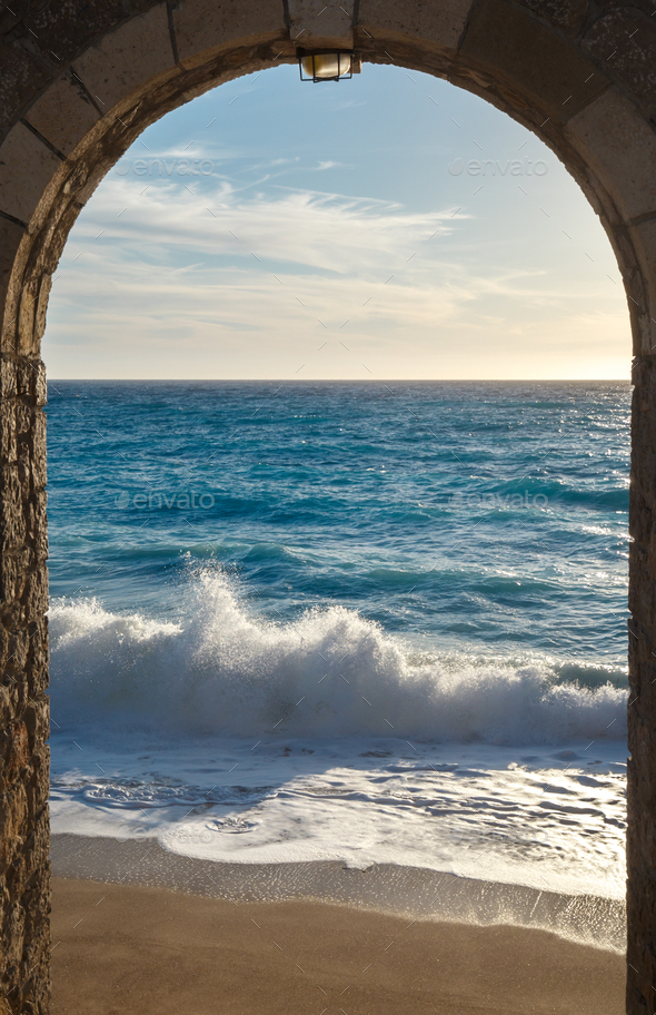 Seashore view through the arch - Stock Photo - Images