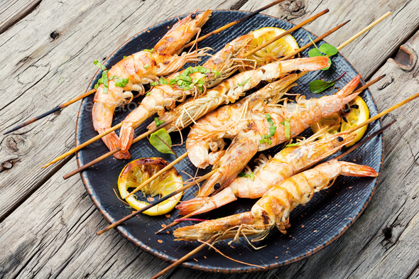 Langoustines or prawns on a skewer - Stock Photo - Images