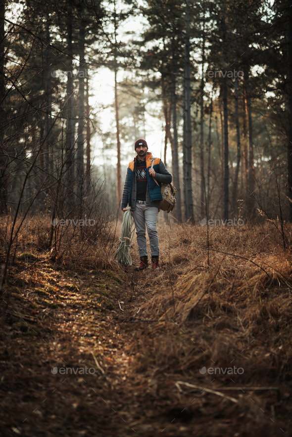Hiker man in the forest - Stock Photo - Images