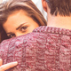 Attractive girl hugging her boyfriend and looking at the camera - PhotoDune Item for Sale