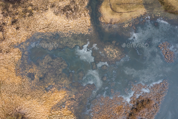 Flooded meadow with water standing in grass from directly above in wetland area - Stock Photo - Images