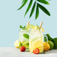 Lemonade and mojito on blue sky background close up - PhotoDune Item for Sale