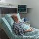 Senior woman patient in hospital room getting medicine through intravenous line - PhotoDune Item for Sale