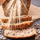 Loaf of wholegrain bread for breakfast, ingredients for baking and ears of rye or wheat grain - PhotoDune Item for Sale
