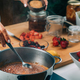 Woman Cooking Fruits and Making Homemade Jam. - PhotoDune Item for Sale