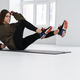 Athletic young sportswoman doing exercise while working out - PhotoDune Item for Sale