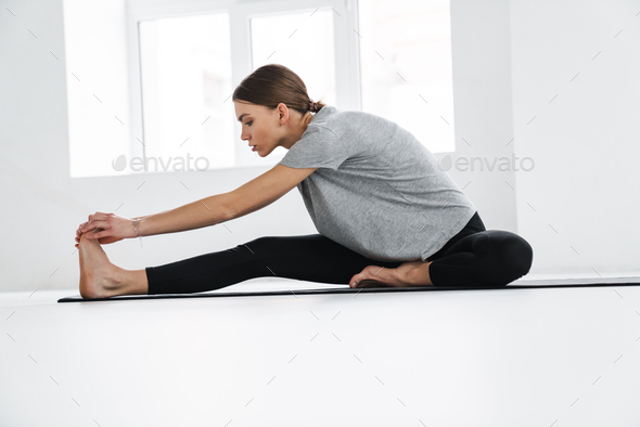 Healthy attractive young yoga woman stretching - Stock Photo - Images