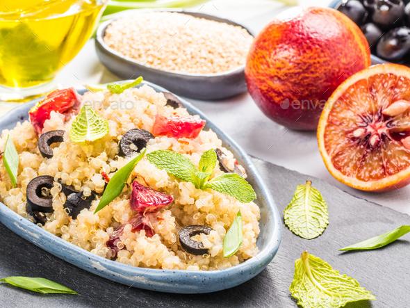 Vegan salad with quinoa, red orange and black olives - Stock Photo - Images