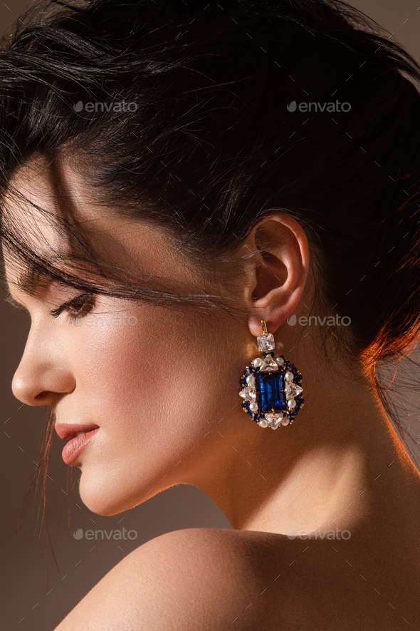 Elegant young woman with beautifully styled hair in studio - Stock Photo - Images