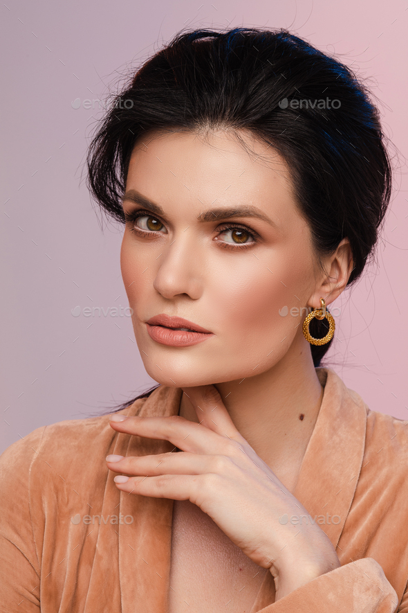 Elegance adult woman is looking at camera - Stock Photo - Images