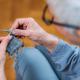 Knitting. Senior Woman Knitting at Home. - PhotoDune Item for Sale