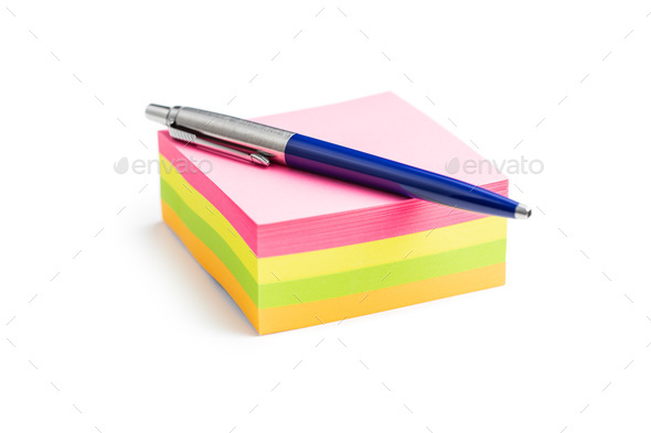 Blank sticky paper notepad and pen. - Stock Photo - Images