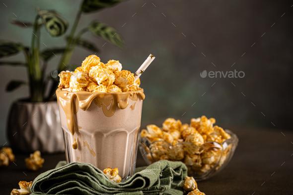 Popcorn milkshake with sea salt caramel - Stock Photo - Images