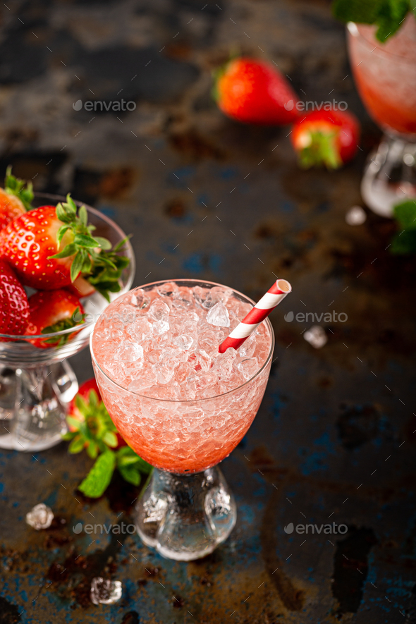 Fresh cocktail with crushed ice, strawberry and mint - Stock Photo - Images