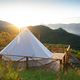 glamping tent in the morning sunlight with mountain range panorama - PhotoDune Item for Sale