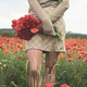 young woman holding a bouquet of poppies in a beautiful field - PhotoDune Item for Sale