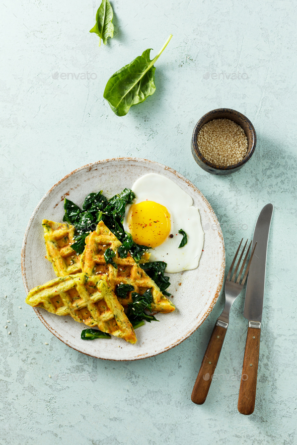 Healthy breakfast with egg, spinach and cheese waffles with herbs - Stock Photo - Images