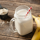 Whey protein cocktail and banana fruit on wooden table - PhotoDune Item for Sale