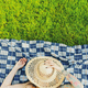 Mid Age Tattooed Woman Relaxing on Blanket in Backyard garden at Summer - PhotoDune Item for Sale