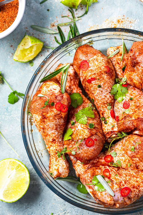 Chicken Legs Drumstick Preparation for BBQ Grill. Marinating Food in SPices - Stock Photo - Images