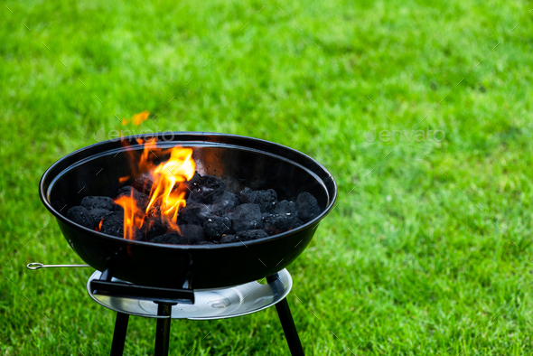 Fire Flames on Grill. Barbeque in Backyard Garden - Stock Photo - Images