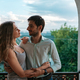 Portrait couple hugging on balcony - PhotoDune Item for Sale