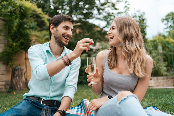 Couple drinking sparkling wine with strawberries - Stock Photo - Images
