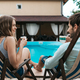 Man and woman spend time together near the pool drinking tea - PhotoDune Item for Sale