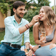 Couple drinking sparkling wine with strawberries - PhotoDune Item for Sale