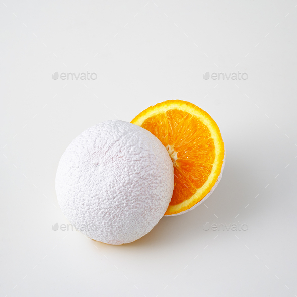 Surreal idea of an unreal white cut orange fruit on a white background. - Stock Photo - Images