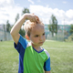 Sweaty focused little soccer player during match on football field, real fan and future champion - PhotoDune Item for Sale