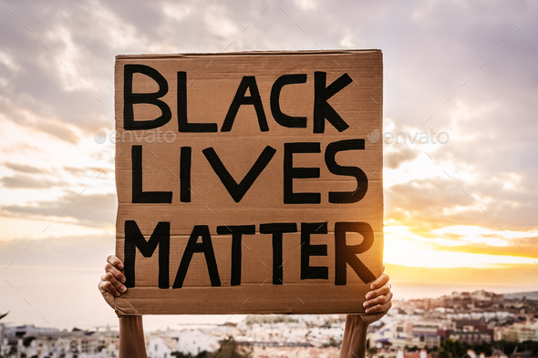 Black lives matter banner - Activist movement protesting against racism and fighting for equality - Stock Photo - Images